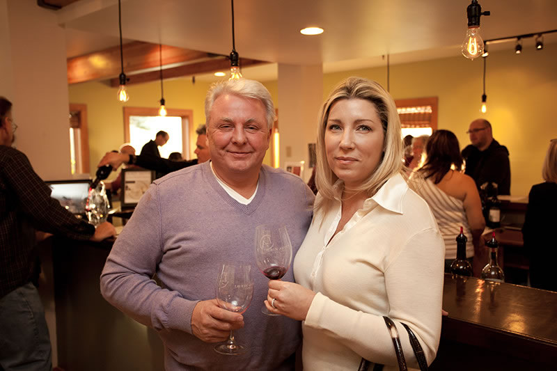 Fall Harvest Fete Couple Smiling with Red Wine in Their Glass
